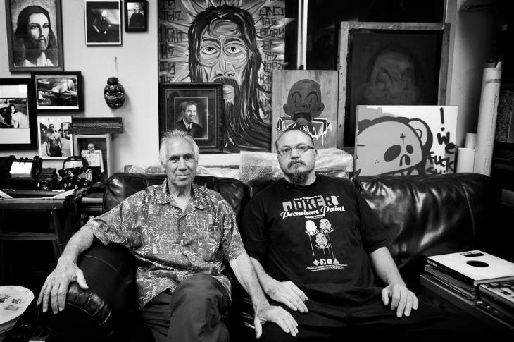 Eriberto and his son, Estevan Oriol in Estevan's downtown LA office. Above Eriberto Oriol is an old picture of himself.