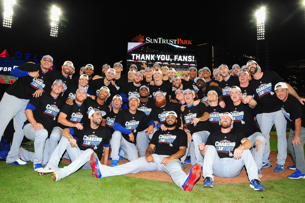 The Los Angeles Dodgers pose together in celebration of winning Game Four of the National League Division Series with a score of 6-2 over the Atlanta Braves at Turner Field on October 8, 2018 in Atlanta, Georgia.