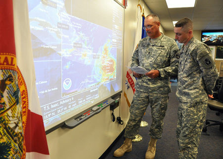 Master Sgt. James Kersey (left) and Sgt. 1st Class Chris Brunner of the 53rd Infantry Brigade Combat Team monitor the track of Tropical Storm Isaac from the Florida National Guard's Joint Emergency Operations Center in St. Augustine, Fla., Aug. 22, 2012.