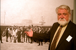 Former Norton Simon museum (nee Pasadena Art Museum) curator Fred Parker, in front of a photo of famous photographers gathered on the museum steps for a much earlier exhibit. Parker's not in the photo because he took it.