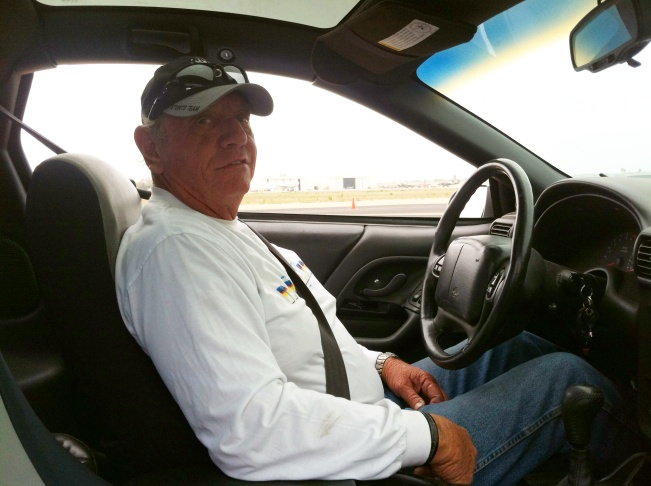 Jim Wilkey supervises student stunt drivers at a stunt driving school at the Camarillo Airport.