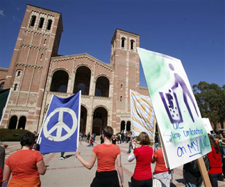 "Demonstrators carrying a banner that says ""I Can't Afford to go to College. Solution: No Cuts"" past Royce Hall on the campus at UCLA in Los Angeles Thursday, March 4, 2010. Students, teachers, parents and others rallied throughout California and many other states to protest deep cuts in funding for schools and universities. Governor Jerry Brown announced another round of cuts to higher education Monday, Jan. 10, 2010."