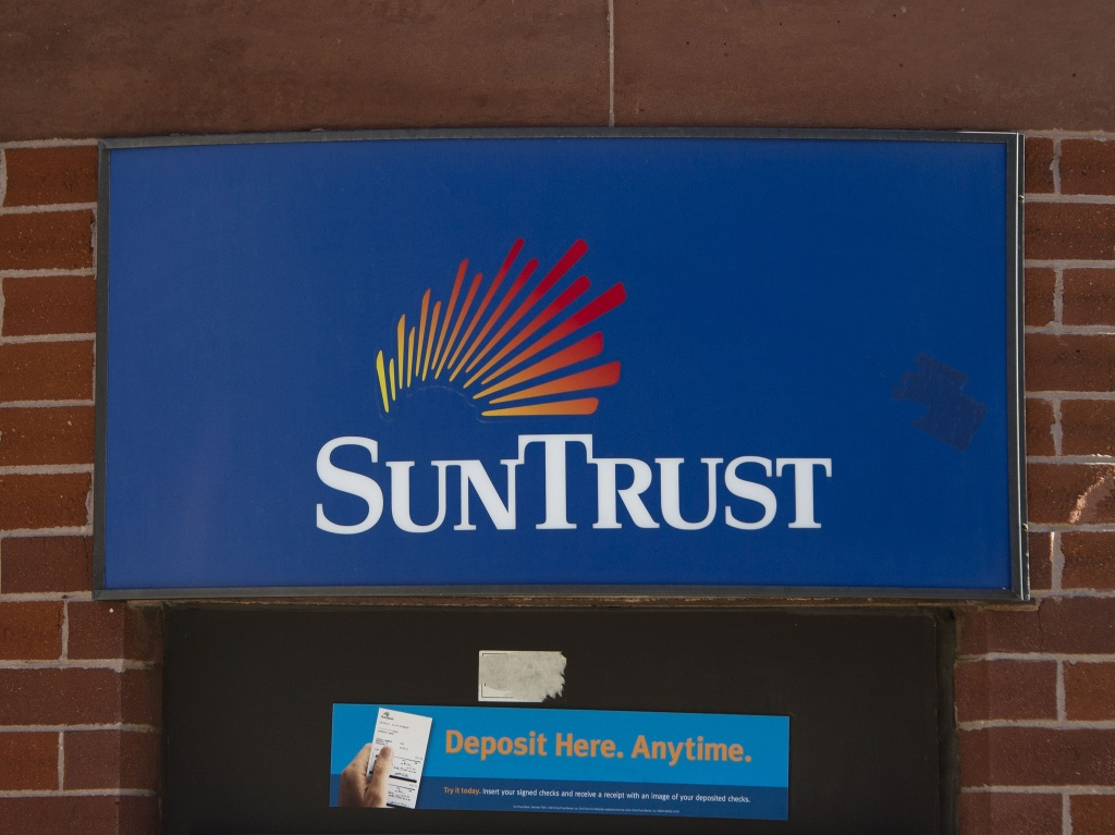 Under legislation approved by the House on Tuesday, SunTrust and other banks with up to $250 billion in assets could be exempted from the toughest rules of the Dodd-Frank law.