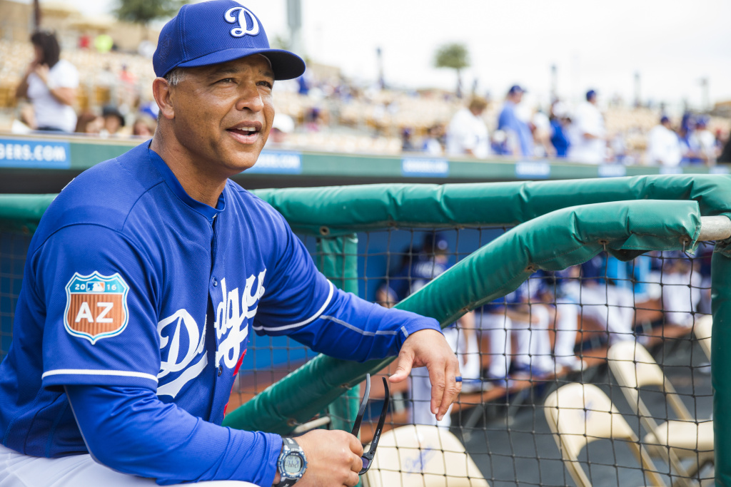 Los Angeles Dodgers manager Dave Roberts looks on during a spring training game against the Chicago White Sox at Camelback Ranch on March 3, 2016 in Glendale, Arizona.