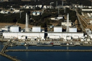 An aerial view shows the quake-damaged Fukushima nuclear power plant in the Japanese town of Futaba, Fukushima prefecture on March 12, 2011. The operator of Japan's tsunami-ravaged nuclear power plant said Wednesday that work was steadily progressing in its plans to remove fuel rods from a cooling pool at the center of international concerns.The Fukushima Dai-ichi nuclear power plant suffered meltdowns at three reactors as a result of the March 2011 earthquake and tsunami.
