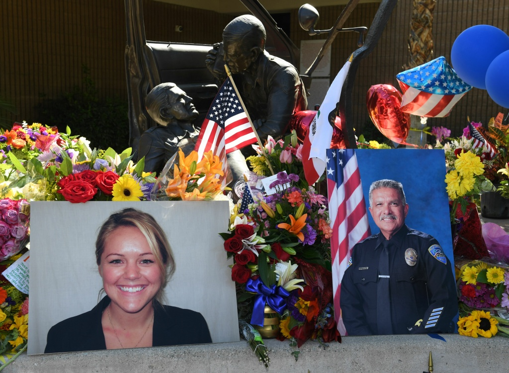 File: A memorial to slain police officers Lesley Zerebny (L) and Jose Gilbert Vega after they were shot by suspect John Hernandez Felix, 26, when the officers responded to a domestic disturbance in Palm Springs on Oct. 9, 2016.