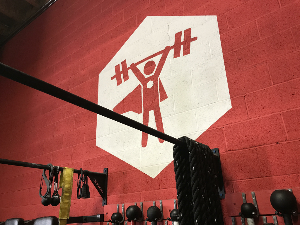 The Nerdstrong logo that people see as they enter the gym
