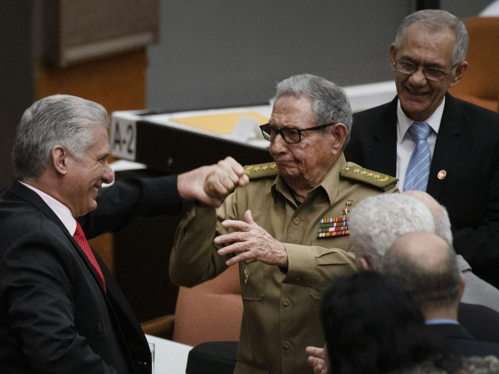 Raul Castro, first secretary of the Communist Party and former president, clasps hands with Cuban President Miguel Diaz-Canel during the closing session at the National Assembly of Popular Power in 2019 in Havana.