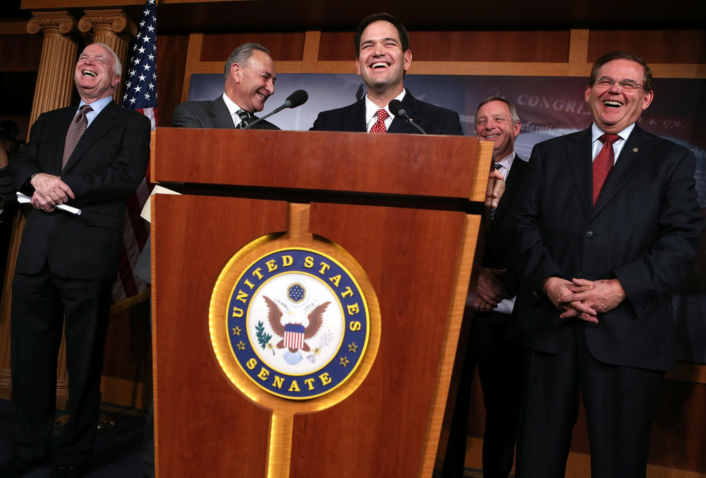 U.S. Sen. John McCain (R-AZ), Sen. Charles Schumer (D-NY), Sen. Marco Rubio (R-FL), Senate Majority Whip Sen. Richard Durbin (D-IL), and Sen. Robert Menendez (D-NJ) share a moment during a news conference on their comprehensive immigration reform framework January 28, 2013 on Capitol Hill in Washington, DC.
