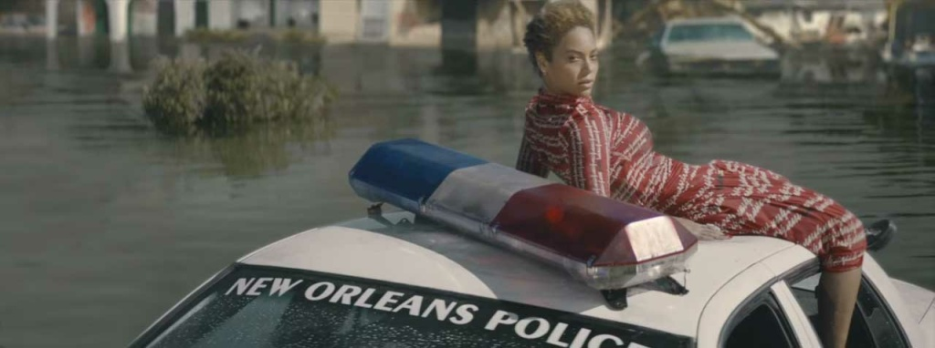 Beyoncé sits on top of a sinking New Orleans police car in this screengrab from the video for