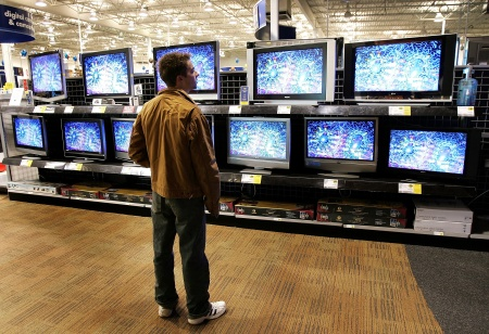 Nick Hehn shops for flat-panel wide screen televisions at a Best Buy store January 31, 2006 in Niles, Illinois.