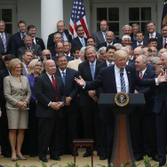 President Donald Trump (C) speaks while flanked by House Republicans after they passed legislation aimed at repealing and replacing the Affordable Care Act
