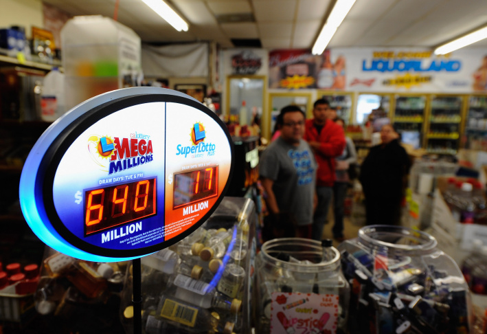 A sign displays of the $640 Mega Millions jackpot at Liquorland on March 30, 2012 in Covina, California. The Mega Millions jackpot has reached a high of $640 million  before the drawing tonight.