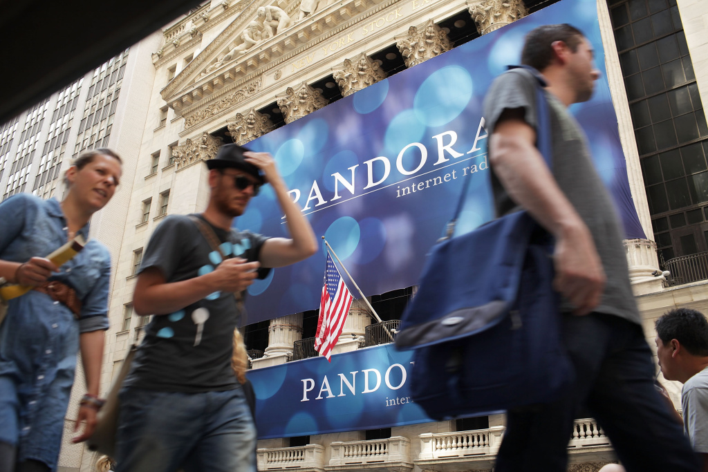 File photo: A banner for Pandora Media Inc., the online-radio company, hangs in front of the New York Stock Exchange walk on its first day of trading as a public company on June 15, 2011 in New York City. The Internet radio leader has reached its first-ever direct licensing deal with artists.