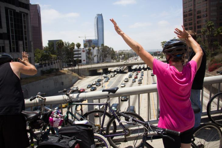 CicLAvia volunteers encourage riders at the Koreatown Hub of CicLAvia on June 23, 2013.
