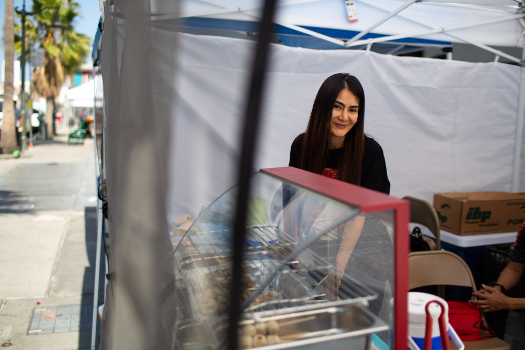Iririn Srirada sells papaya salad and other items at the East Hollywood Farmers Market, June 6, 2019. (James Bernal for KPCC)