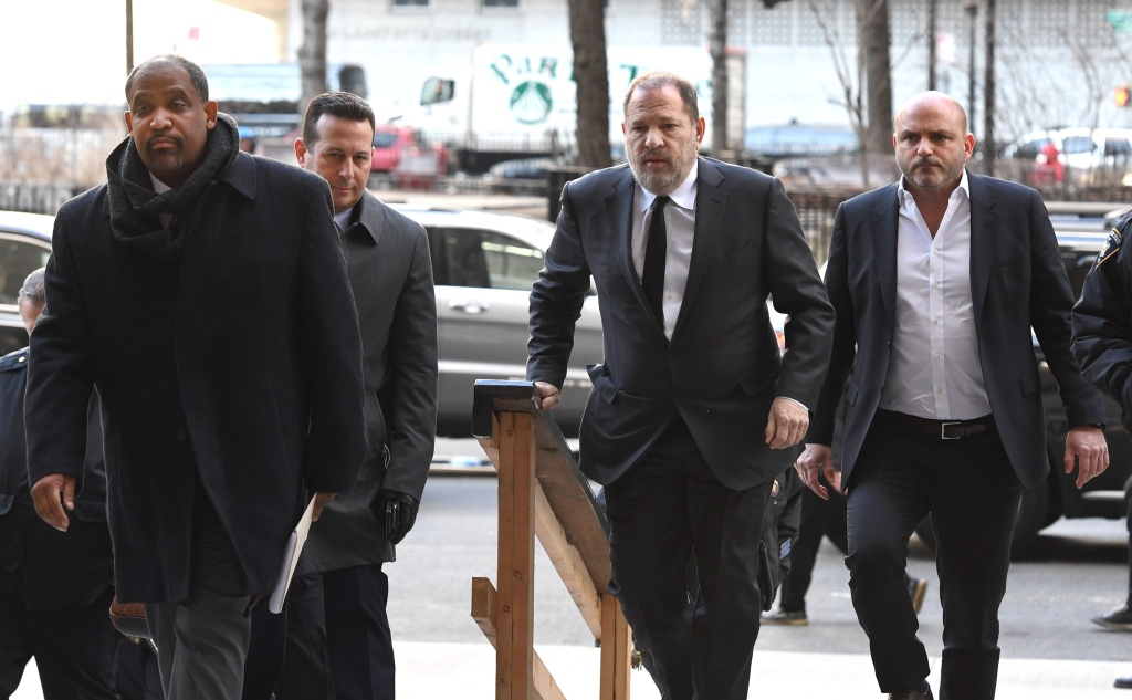 Disgraced Hollywood producer Harvey Weinstein arrives State Supreme Court in Manhattan with his new team of lawyers Jose Baez (2nd L), Ronald Sullivan (L) in New York on January 25, 2019.