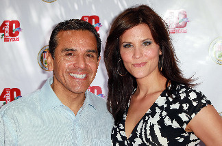 Los Angeles Mayor Antonio Villaraigosa (L) and broadcast journalist Lu Parker attend a garden party hosted by Villaraigosa in honor of LA Pride at Getty House on June 6, 2010 in Los Angeles, California.