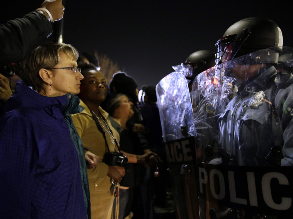 Police and protesters square off outside the Ferguson Police Department, in March.