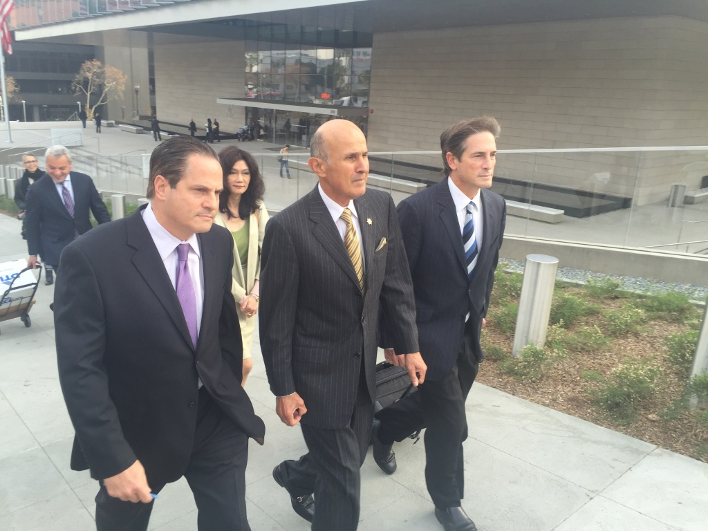 Former L.A. County Sheriff Lee Baca, center, leaves the federal courthouse on Wednesday, Dec. 14, 2016. His attorney, Nathan Hochman, is on his left.