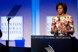 First Lady Michelle Obama speaks while former President Bill Clinton looks on during the closing plenary session of the annual Clinton Global Initiative (CGI) on September 23, 2010 in New York City.