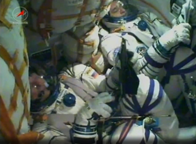 Video from inside a Russian Soyuz space capsule shows NASA astronaut Scott Kelly and cosmonaut Mikhail Kornienko of the Russian Federal Space Agency. The two were on their way to the International Space Station, where Kelly will attempt to become the first American to spend a year in space.