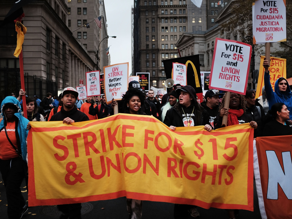 Low-wage workers and supporters protest for a $15 an hour minimum wage Tuesday in New York City as part of what organizers called a National Day of Action.
