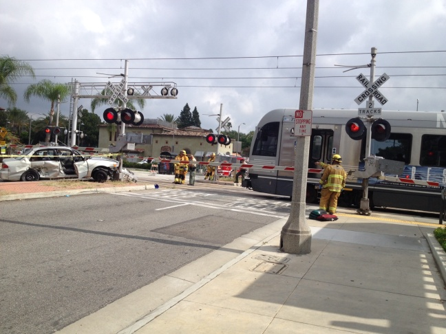 A Metro train collided with a Toyota Corolla Sunday, briefly shutting down service on the Gold Line.