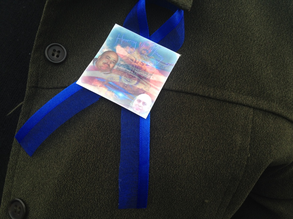 Friends and co-workers of TSA officer Gerardo Hernandez made blue-ribbon pins to wear to the memorial in honor of their colleague, the first TSA officer to die in the line of duty.