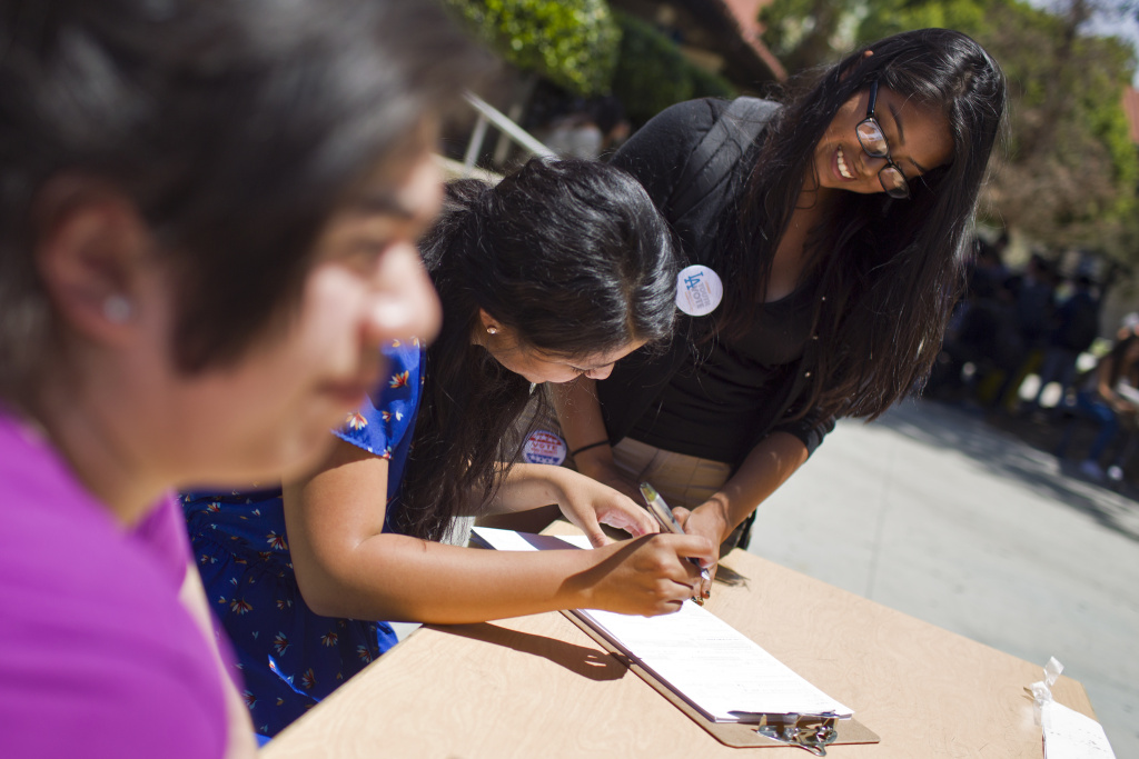 Senior Emily Cisneros, left, helps get students registered to vote during a voter drive at North Hollywood High School on Thursday, April 30, 2015. Cisneros turned 18 in March and immediately registered to vote.