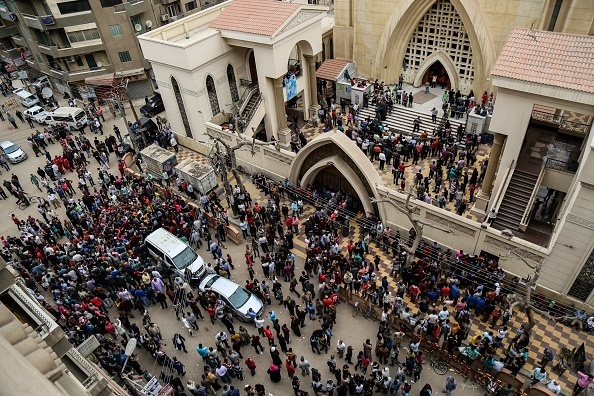 TANTA, EGYPT - APRIL 9: People gather in front of the Saint George church after a bombing struck inside the church in the Nile Delta city of Tanta, Egypt on April 9, 2017. At least 21 people were killed.  (Photo by Ibrahim Ramadan/Anadolu Agency/Getty Images)