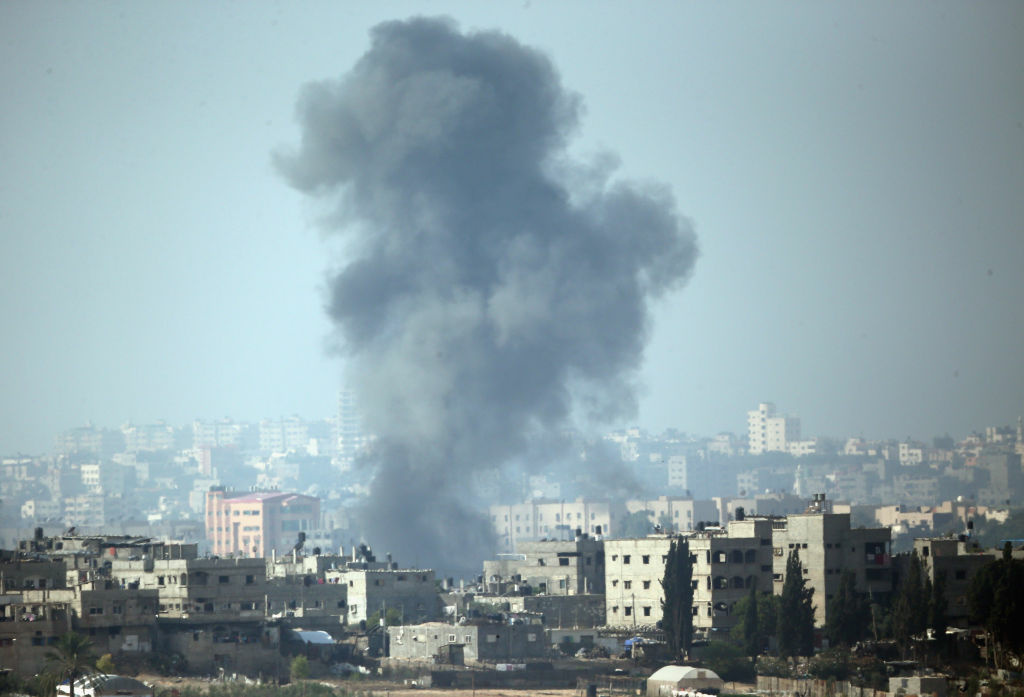 ISRAEL/GAZA BORDER, ISRAEL - NOVEMBER 19:  A plume of smoke rises above Gaza City after an Israeli airstrike on November 19, 2012 on Israel's border with the Gaza Strip. (Photo by Christopher Furlong/Getty Images)