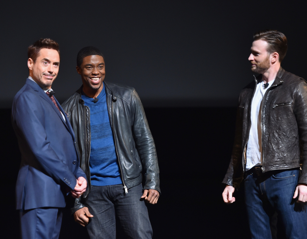 (L-R) Actors Robert Downey Jr., Chadwick Boseman and Chris Evans during Marvel Studios' fan event at The El Capitan Theatre in Los Angeles.