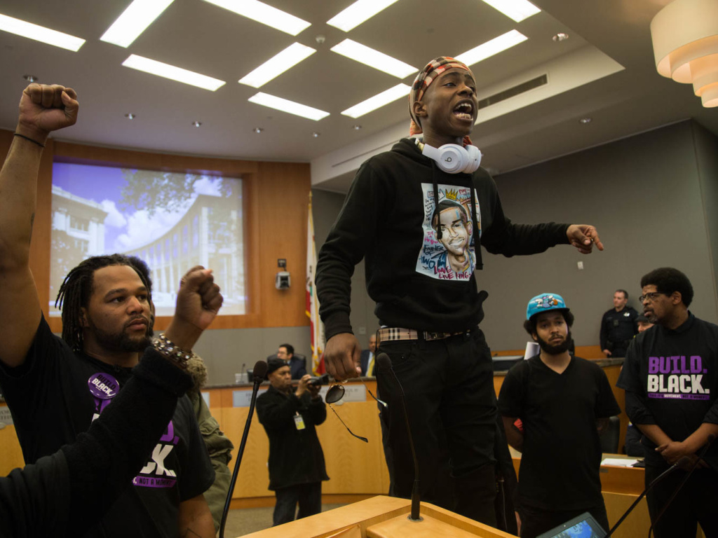 Hundreds showed up for a community forum at City Hall Tuesday. At one point Stephon Clark's brother, Ste'vante Clark, jumped atop the mayor's desk and later stood atop a lectern to deliver emotional, expletive-laden comments.