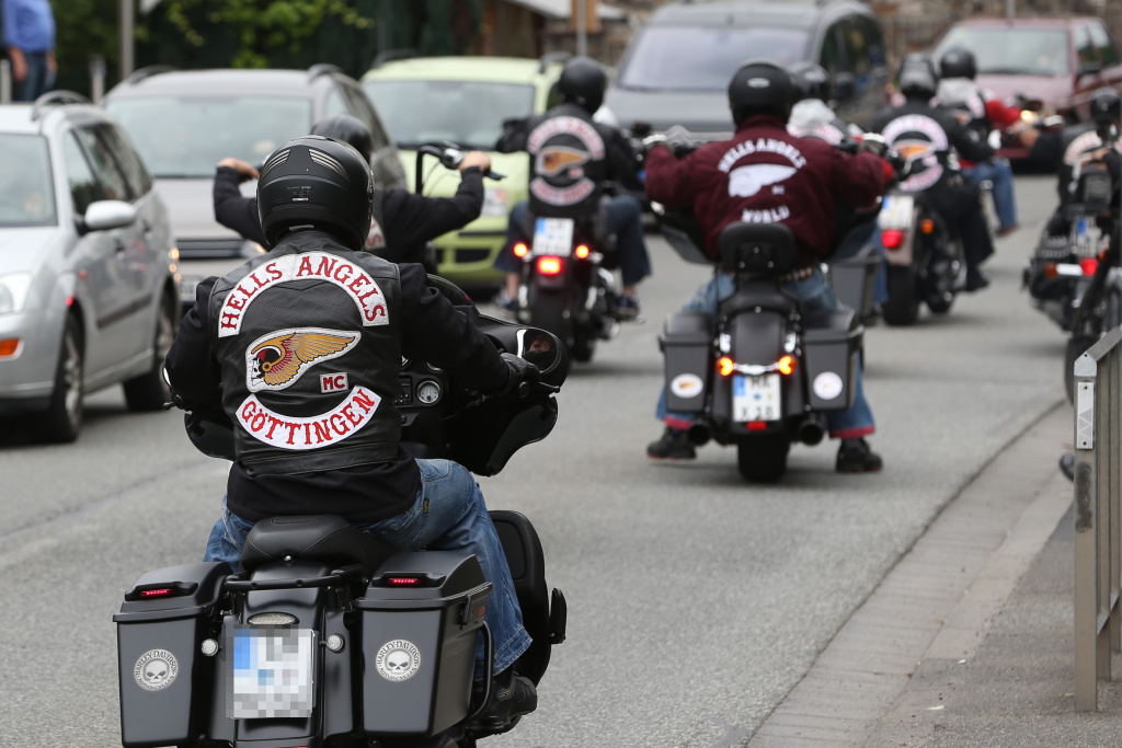 Members of the Hells Angels motorcycle gang wear gear with the club's logo and read