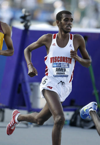 Mohammed Ahmed runs at the NCAA championships in June in Des Moines, Iowa. He's representing Canada at the Olympics and had to decide whether to fast for Ramadan this year.