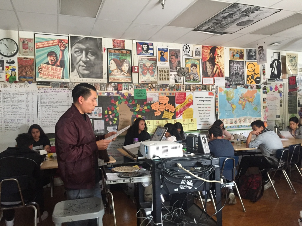 Ethnic studies teacher Jorge Lopez gives instructions for an art project.