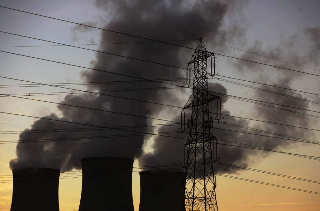 File: The sun sets behind the chimneys at Didcot Power Station, a dual coal and gas fired power station supplying power to the national grid, on December 7, 2008 in Oxfordshire, England.