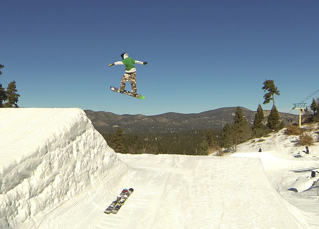 A boarder sails off a jump at Big Bear mountain.