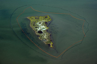 One of the New harbor Islands is protected by two oil booms against the oil slick that has passed inside of the protective barrier formed by the Chandeleur Islands, as cleanup operations continue for the BP Deepwater Horizon platform disaster off Louisiana, on May 10, 2010.
