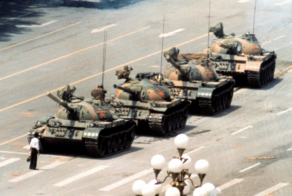 This photograph portrays a lone man opposing the destructive tanks headed towards Tiananmen Square.