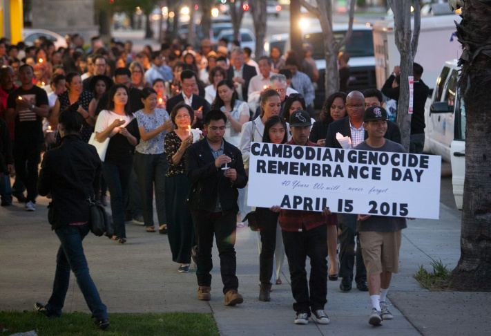 Five-year-old Zyriah Thoeun (center) participates with her family and friends in a candelight vigil during the Cambodian Genocide Remembrance Day event at the Expo Arts Center in Bixby Knolls, (Long Beach), Calif. on Friday, April 17, 2015.
