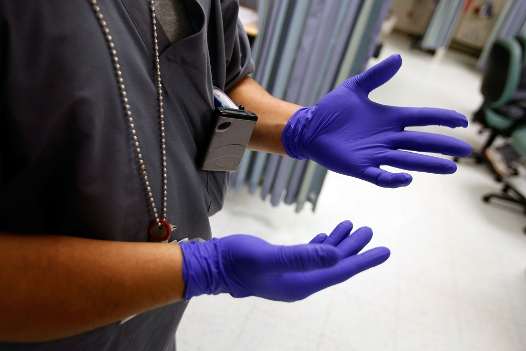 MIAMI - OCTOBER 17:  Miami VA Medical Center hospital registered nurse, Rafael Sepulveda, pulls on rubber gloves while attending to patients in the Emergency room October 17, 2007 in Miami, Florida. The hospital has strict policies in place to ensure that the staff uses procedures in the fight against methicillin-resistant Staphylococcus aureus bacteria, commonly referred to as MRSA. The staph bacterium is resistant to most common antibiotics and has been responsible for more than nearly 19,000 deaths each year, according to the Centers for Disease Control and Prevention  (Photo by Joe Raedle/Getty Images)