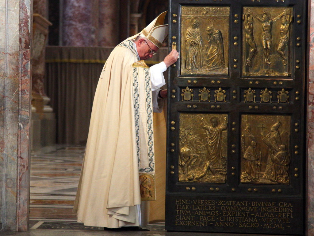Pope Francis closes the Holy Door in St. Peter's Basilica on Sunday in Vatican City, marking the end of the Jubilee Year of Mercy.
