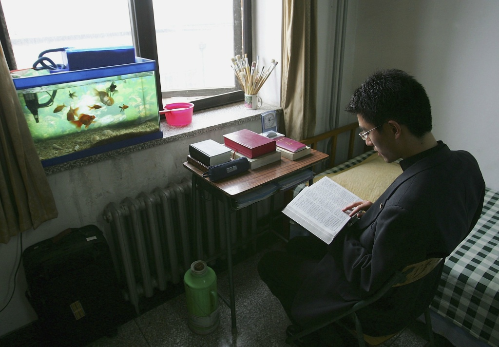 Andreas Ding, 25, from Chongqing city, studies the Bible in his dormitory in the Catholic Seminary of Beijing on May 9, 2006 in Beijing, China.