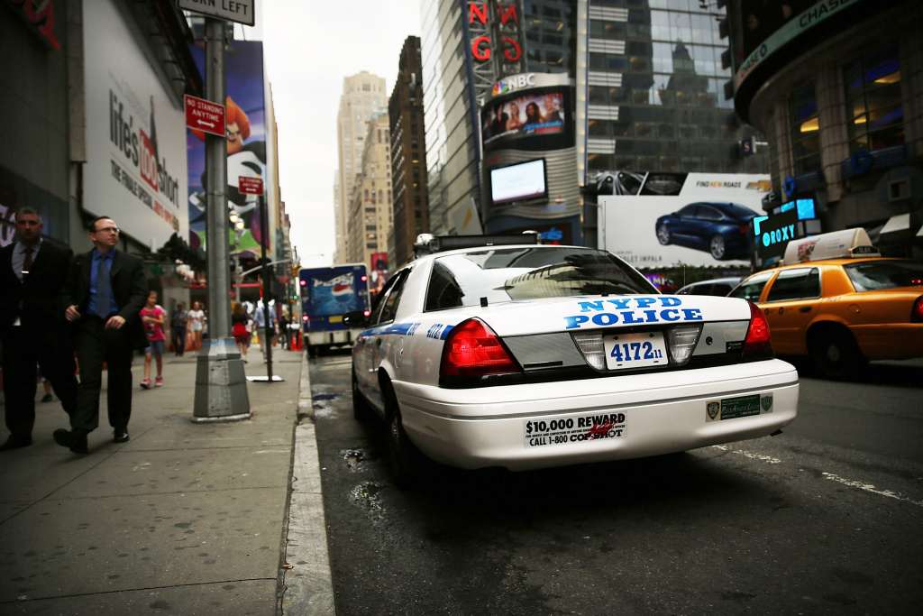 A New York Police Department (NYPD) car sits parked in Times Square on August 12, 2013 in New York City. Some New York City police are accused of faking disabilities to get benefits.