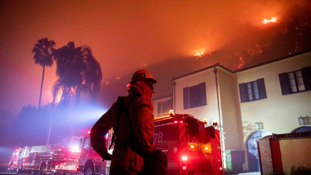 Firefighters establish a perimeter during the Getty fire.