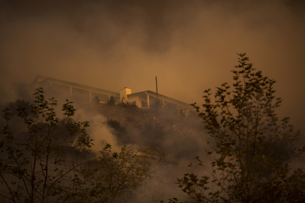 The Thomas Fire passes between homes on December 16, 2017 in Montecito, California.