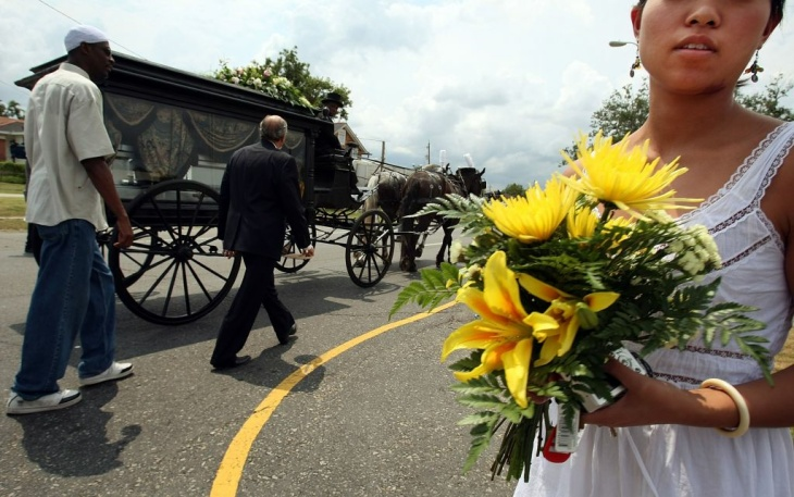 An empty casket honoring children killed by Hurricane Katrina is taken by horse-drawn carriage after a service at St. Paul's Church of God in Christ in the Lower Ninth Ward in New Orleans, Louisiana.