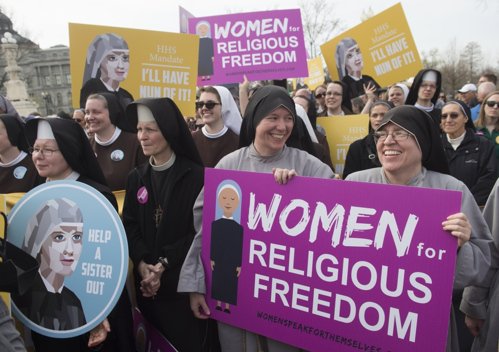 Nuns rally outside the Supreme Court following oral arguments dealing with religious organizations that want to ban contraceptives from their health insurance policies on religious grounds.